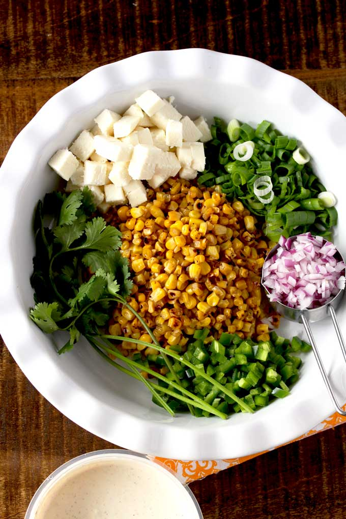 A plate with the ingredients to make Mexican Street Corn Salad.