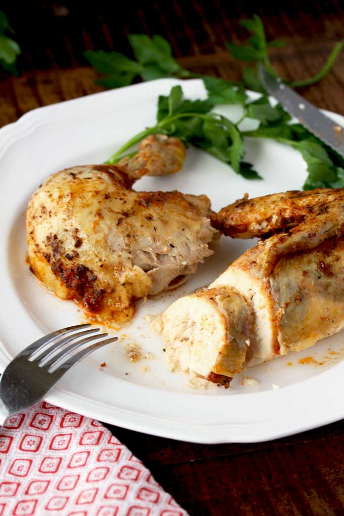 Two pieces of pressure cooker rotisserie chicken on a plate