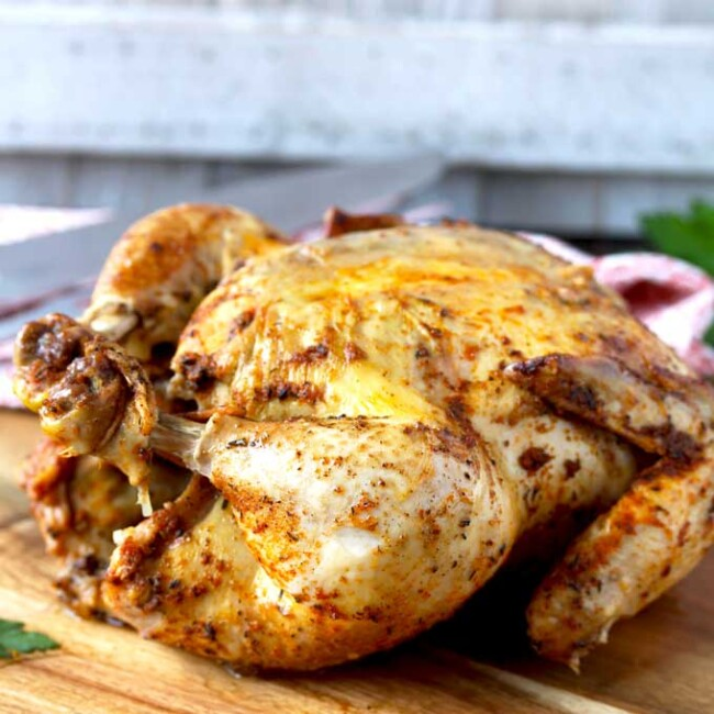 This Pressure Cooker Whole Chicken is easy, juicy, tender and cooks in less than 30 minutes! This rotisserie style instant pot whole chicken is delicious and a great and simple weeknight meal.