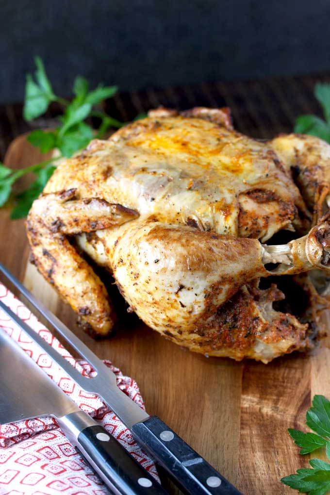 A Pressure Cooker Whole Chicken on a carving board