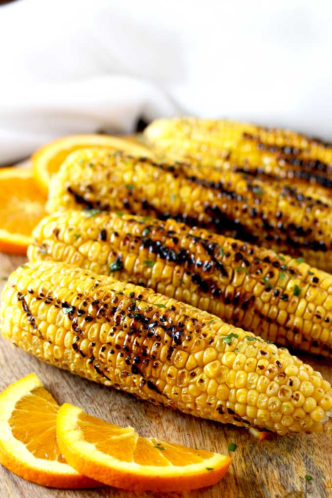 Grilled corn on a wooden board