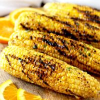 Perfectly grilled corn slathered in the most irresistible, flavorful and easy to make Orange Honey Butter. This grilled corn recipe is the perfect side dish for summer days!