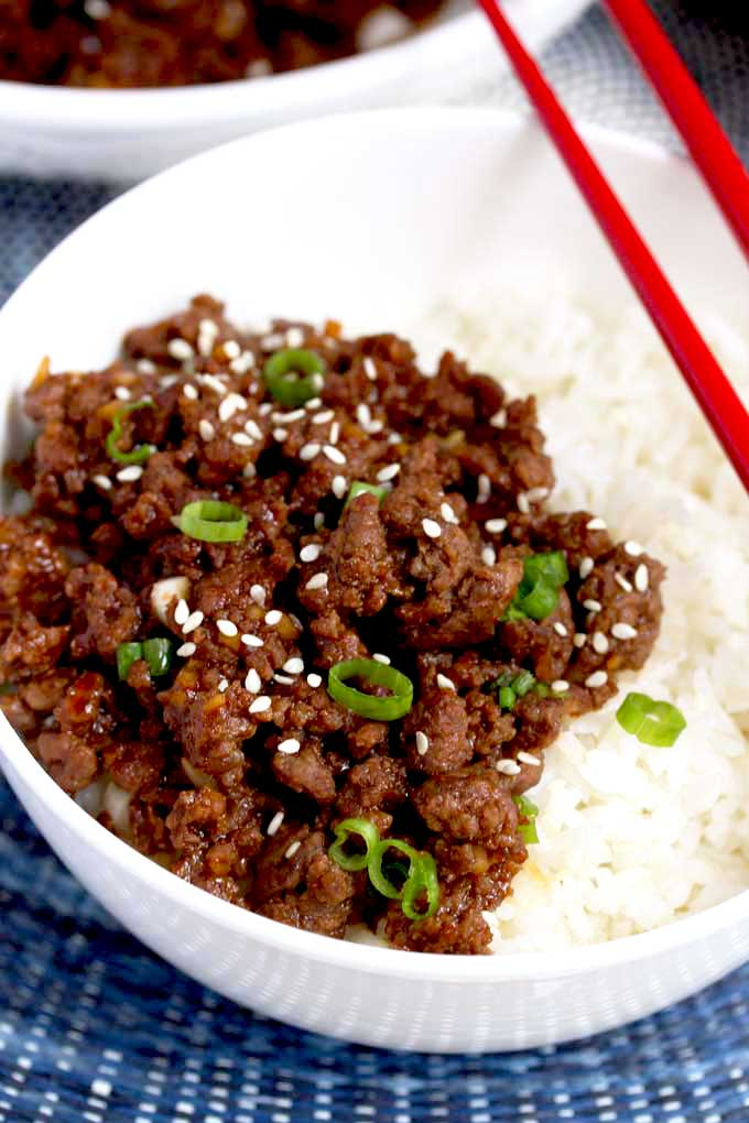 A bowl filled with Korean beef and rice.