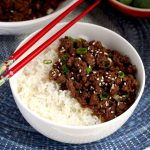 Korean Beef over white rice in a white bowl