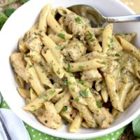 This Chicken Pesto Pasta is loaded with juicy tender chicken smothered in a delicious Creamy Pesto Parmesan Sauce. This easy Chicken Pesto Pasta is guaranteed to become a family favorite!