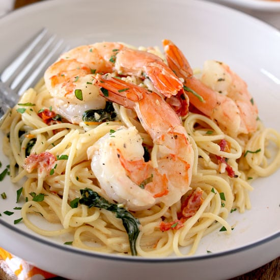 Creamy Tuscan Shrimp over pasta.
