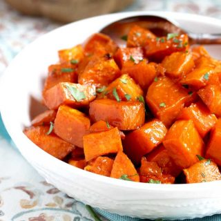 These Oven Roasted Sweet Potatoes are coated in a tasty maple syrup mixture and oven roasted until tender, caramelized and slightly golden. This delicious side dish is easy to make any day of the week and fabulous enough to serve during the holidays!