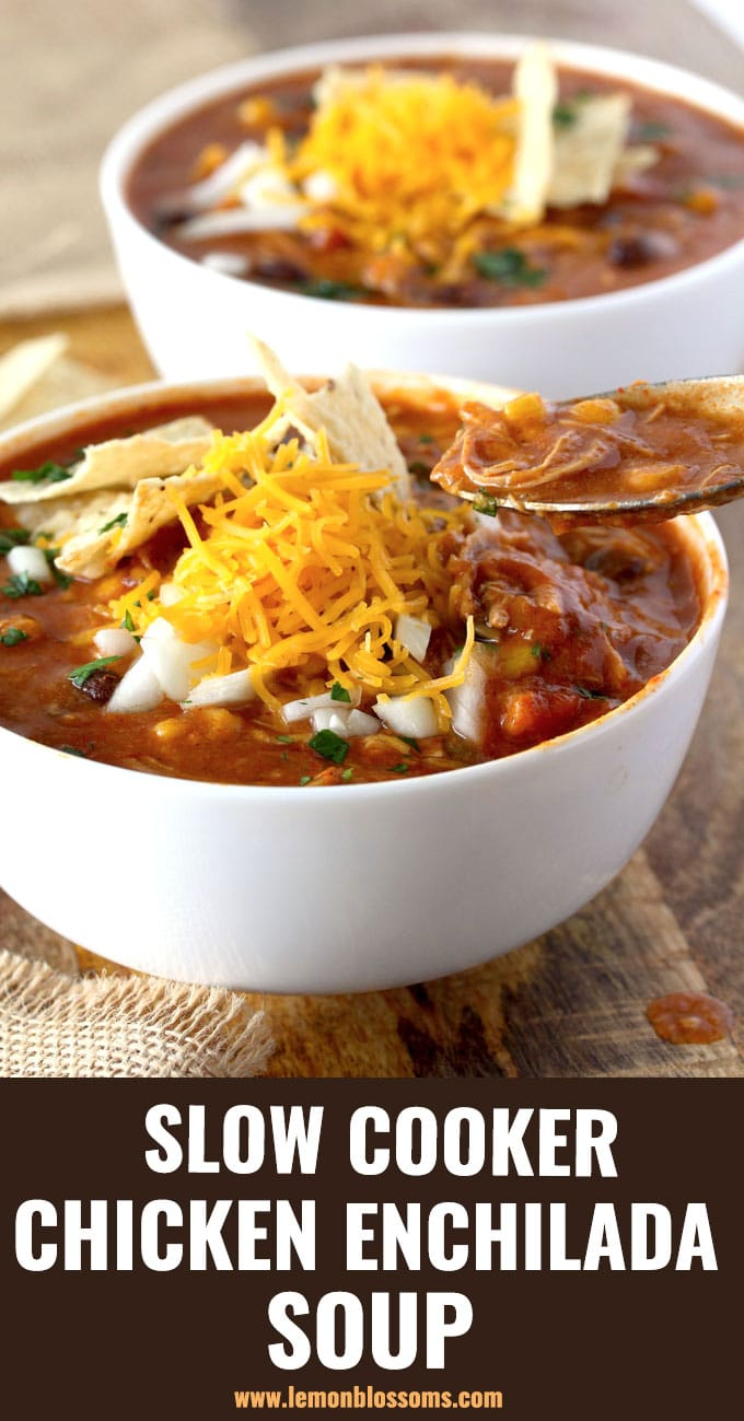 This Chicken Enchilada Soup is loaded with shredded chicken, black beans and corn and topped with your favorite fixings! This creamy, cheesy and hearty Enchilada Soup is made entirely in the slow cooker! #crockpot #soup #chili's #slowcooker #cheesy #easy #recipe
