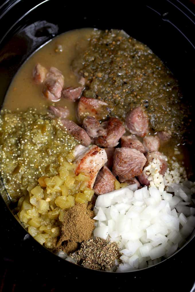 Ingredients to make pork chile verde in a crock pot