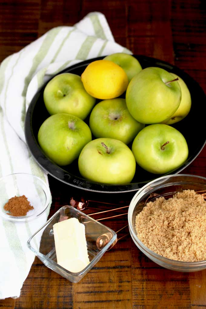 Ingredients to make the caramelized apple topping on a wooden surface.