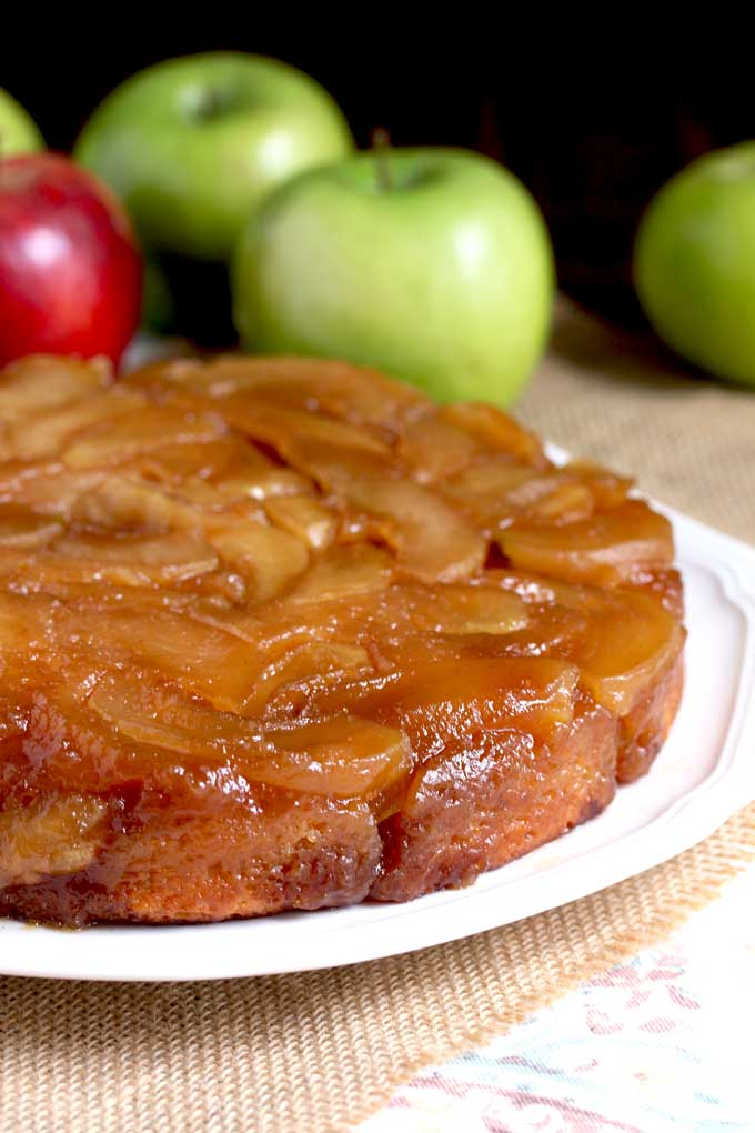 Caramalized Apple Upside Down Cake on a white platter.