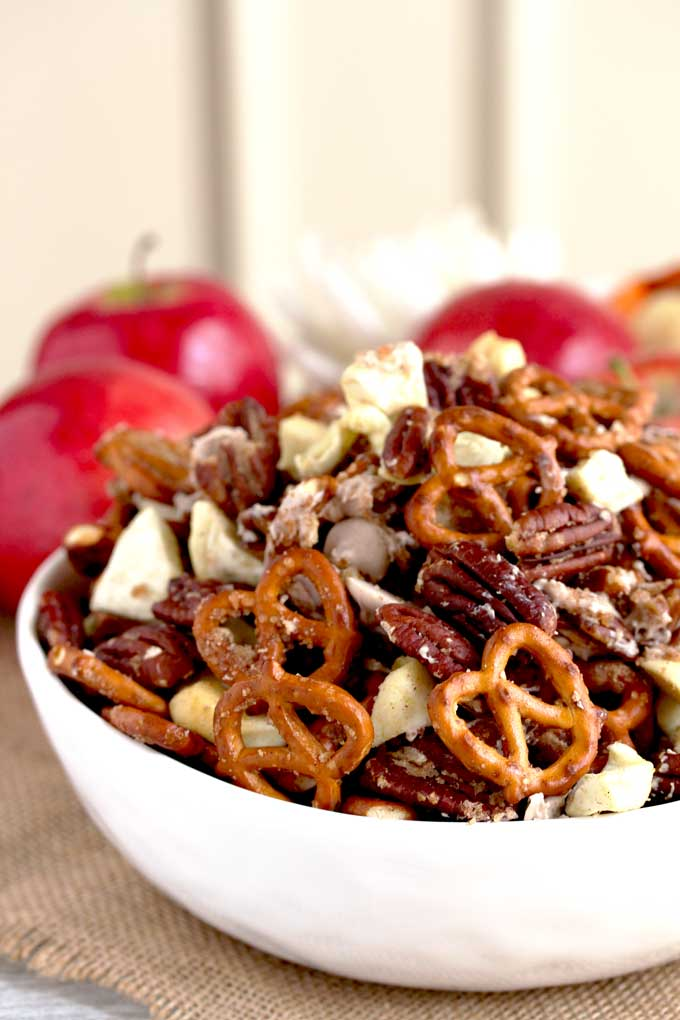 Apple Pie Party Mix in a small white bowl.