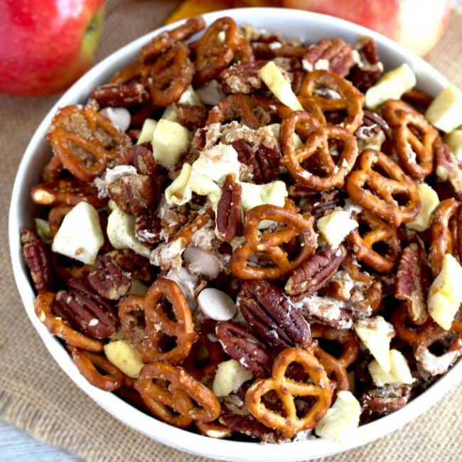Caramel Apple Pie Party Mix in a white bowl.