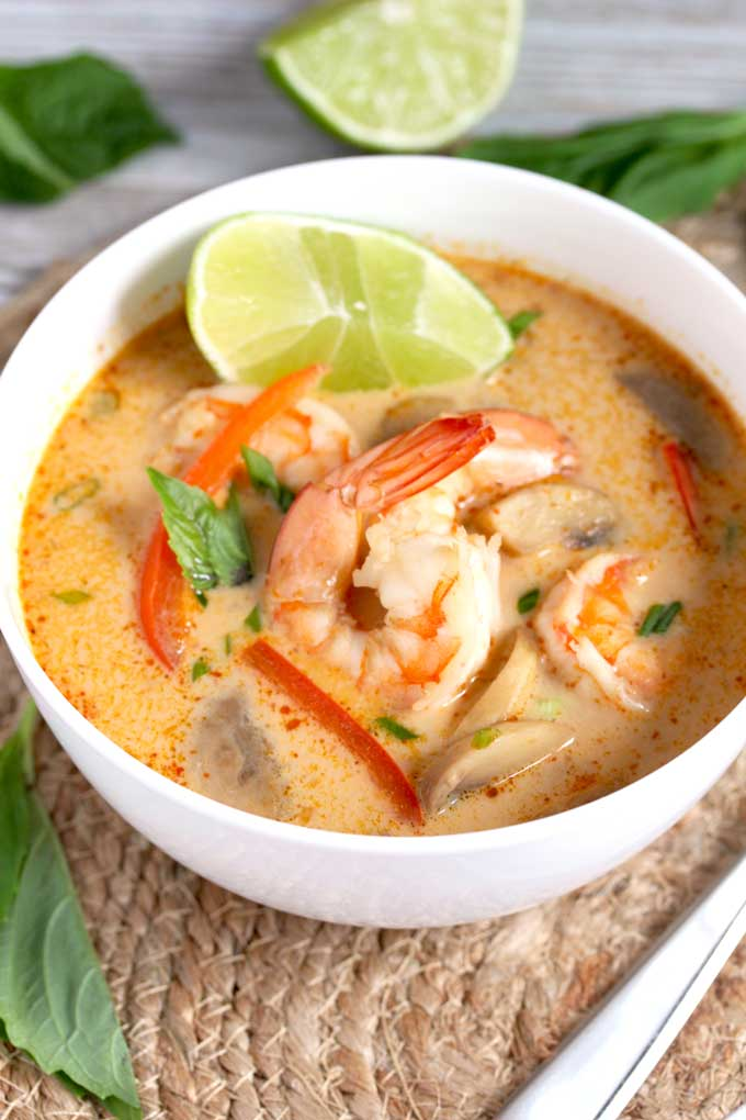 Coconut Curry Soup with Shrimp in a white bowl.