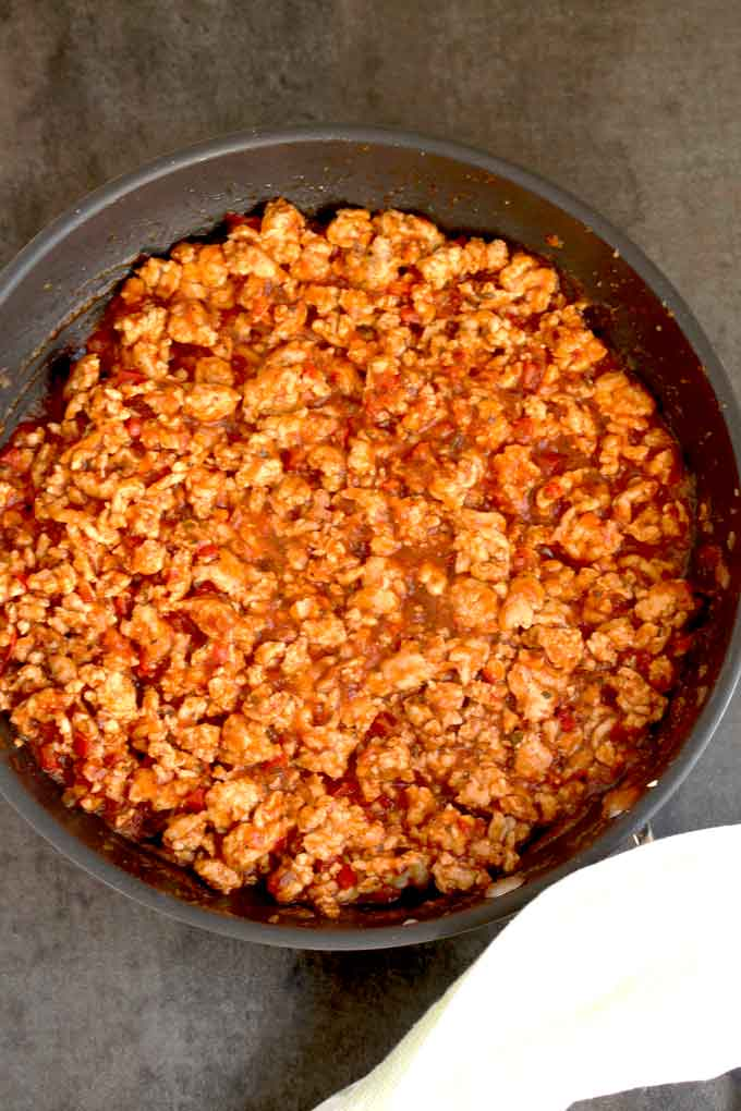 Ground turkey with marinara in a skillet.