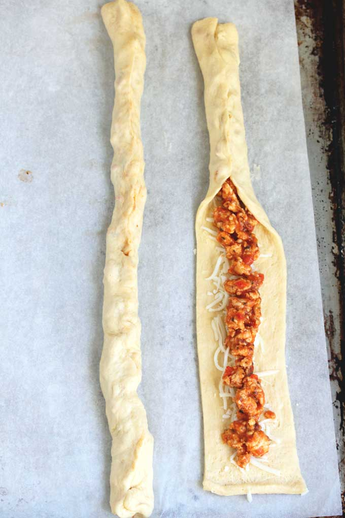 Crescent dough strips filled with cheese and ground turkey filling.