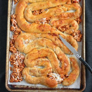 Stuffed Crescent Rolls shaped like intestines on a sheet pan