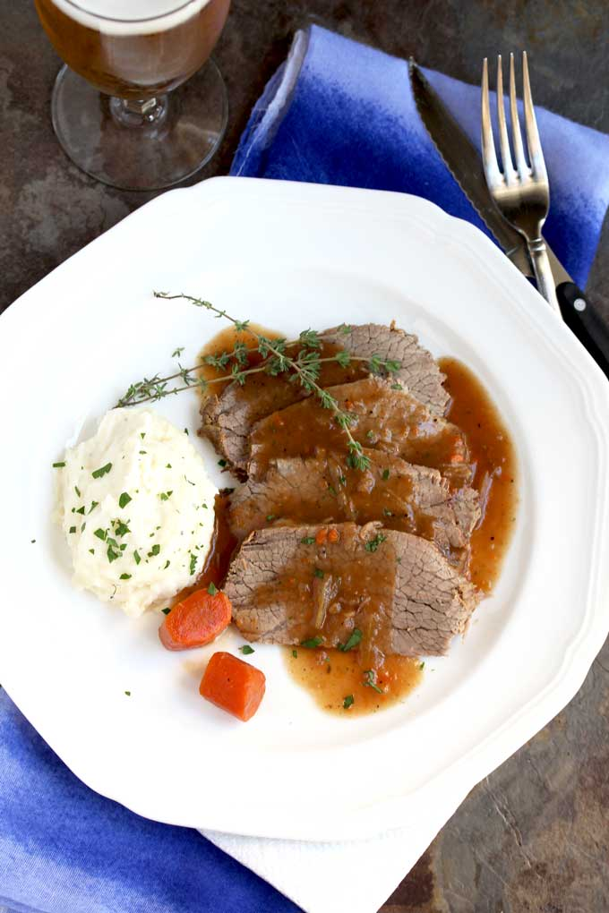 Plated sourbraten with mashed potatoes and carrots