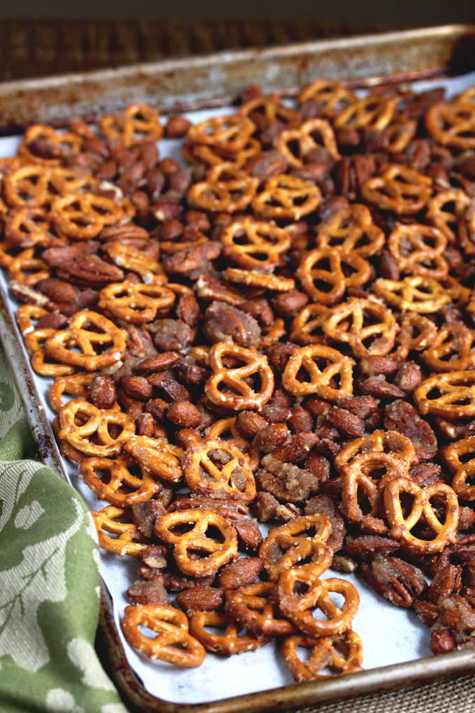 Baked pretzels and nuts on a sheet pan