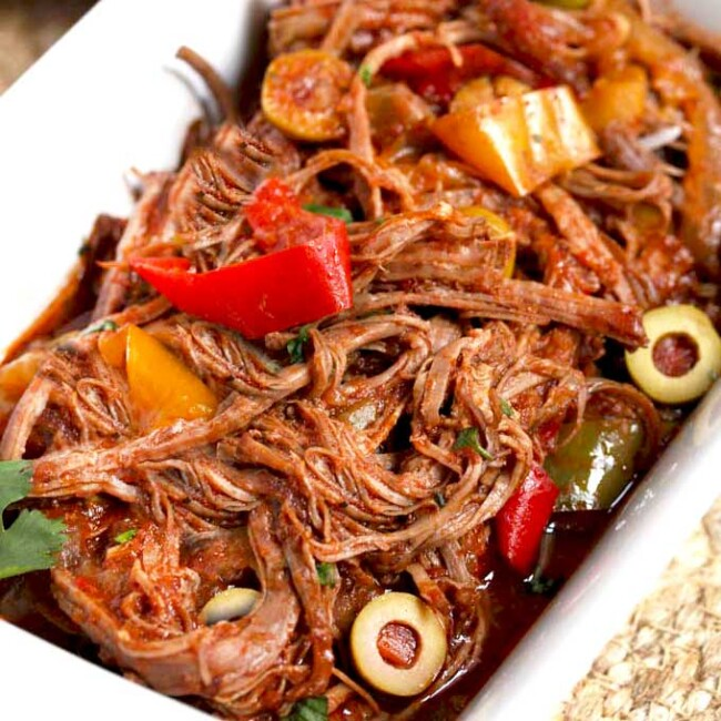 Shredded beef Cuban Ropa Vieja in a white bowl