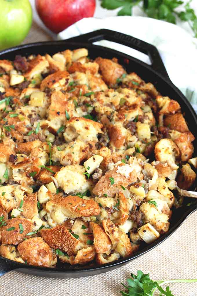 Apple and Sausage Stuffing served from a skillet.