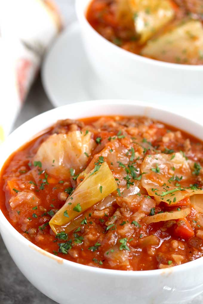 Close up view of a bowl of cabbage roll soup.