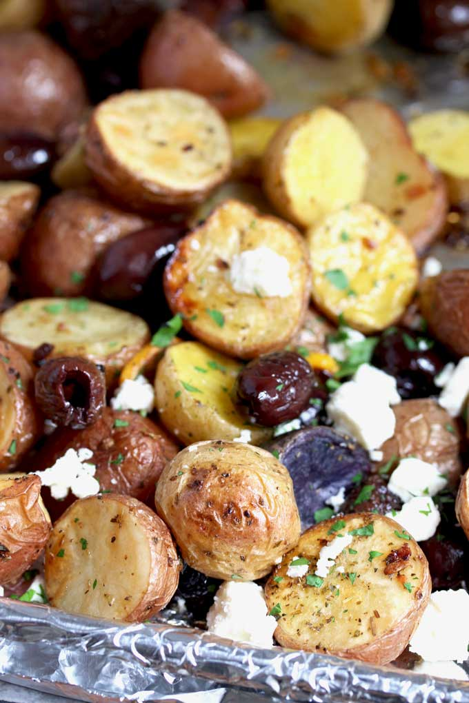 Roasted Greek Potatoes on a sheet pan.