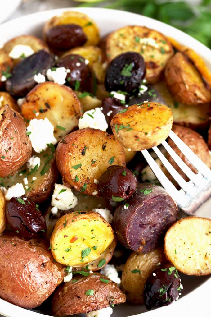 A bowl filled with Roasted Greek Potatoes.