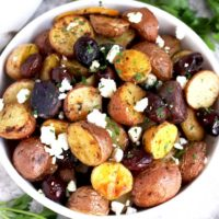 Roasted Greek Potatoes served in a white bowl.