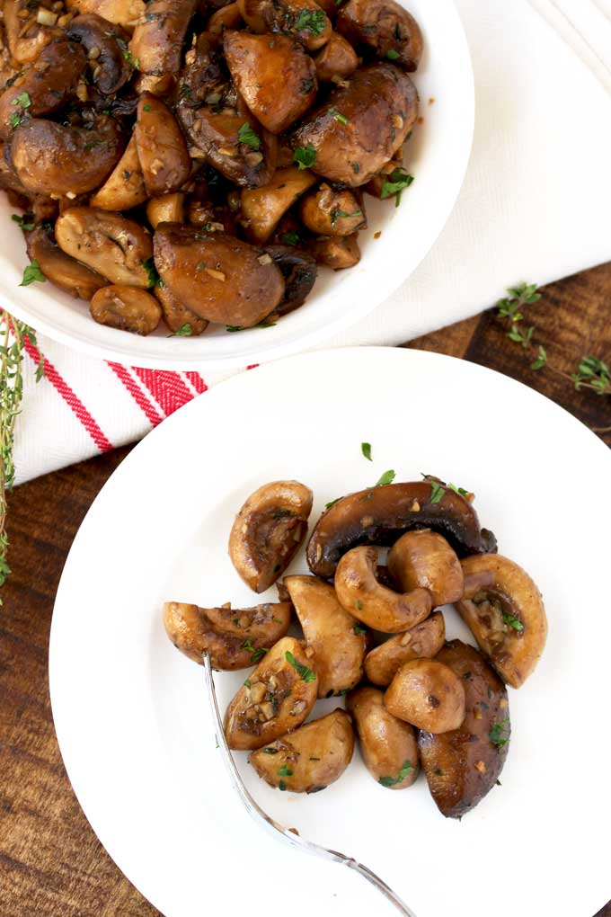 Sauteed mushrooms served on a plate.