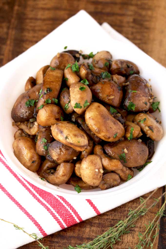 Sauteed Mushrooms piled high on a serving dish.