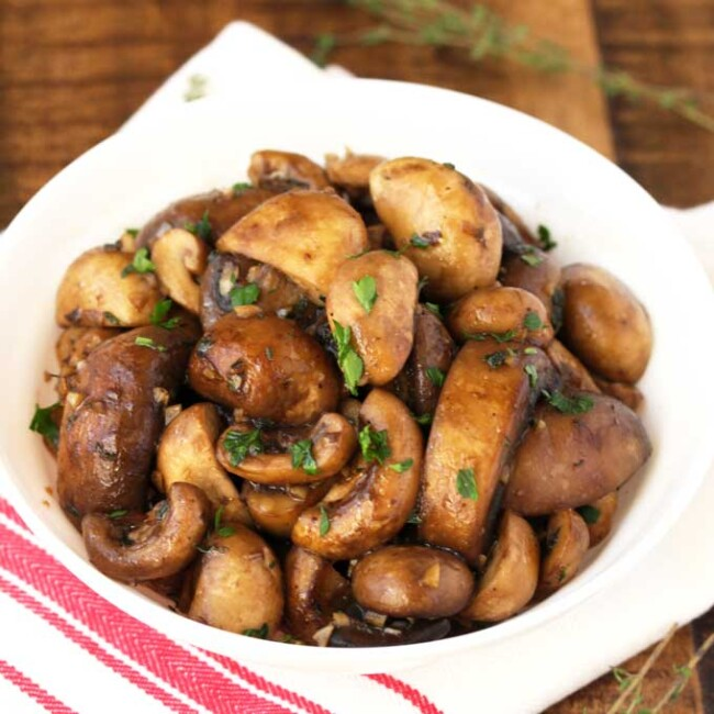 A batch of sauteed mushrooms recipe served on a white bowl