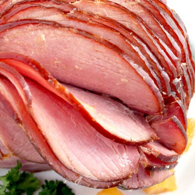 This Slow Cooker Ham is tender, juicy, tasty and perfect for the Holidays! This easy Crock Pot Ham requires minimal prep, a few ingredients and saves you oven space!
