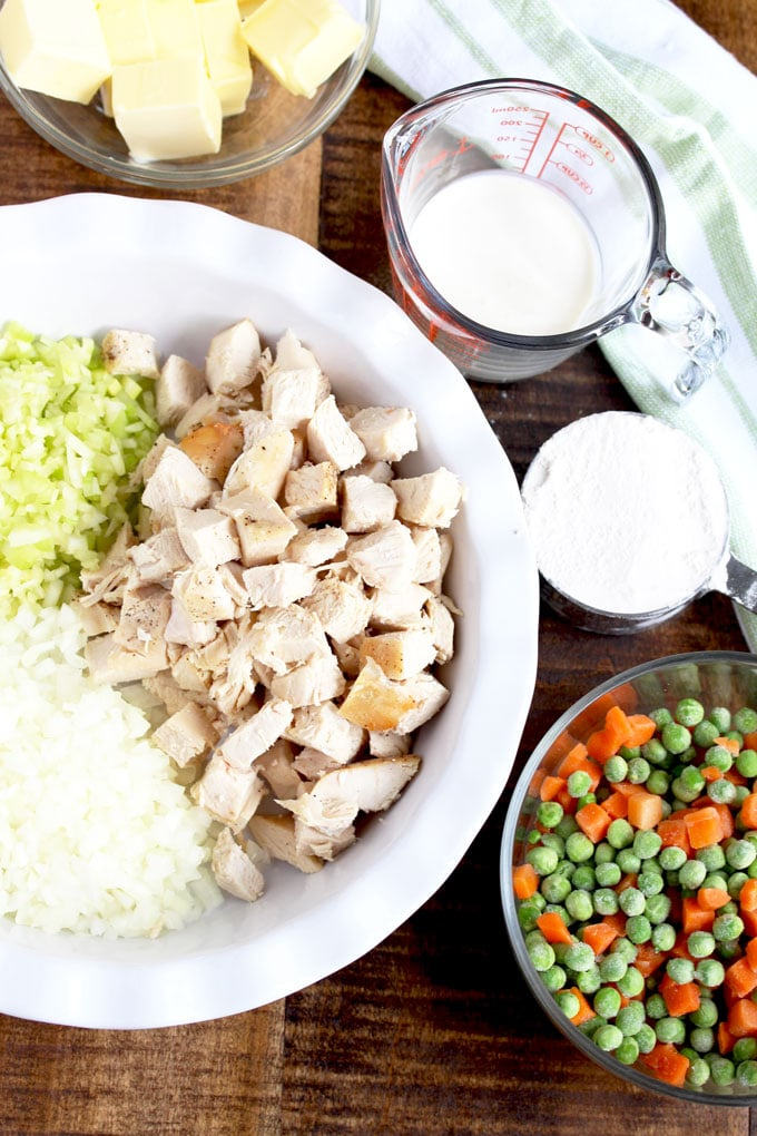 Ingredients to make Turkey Pot Pie on a wooden surface.