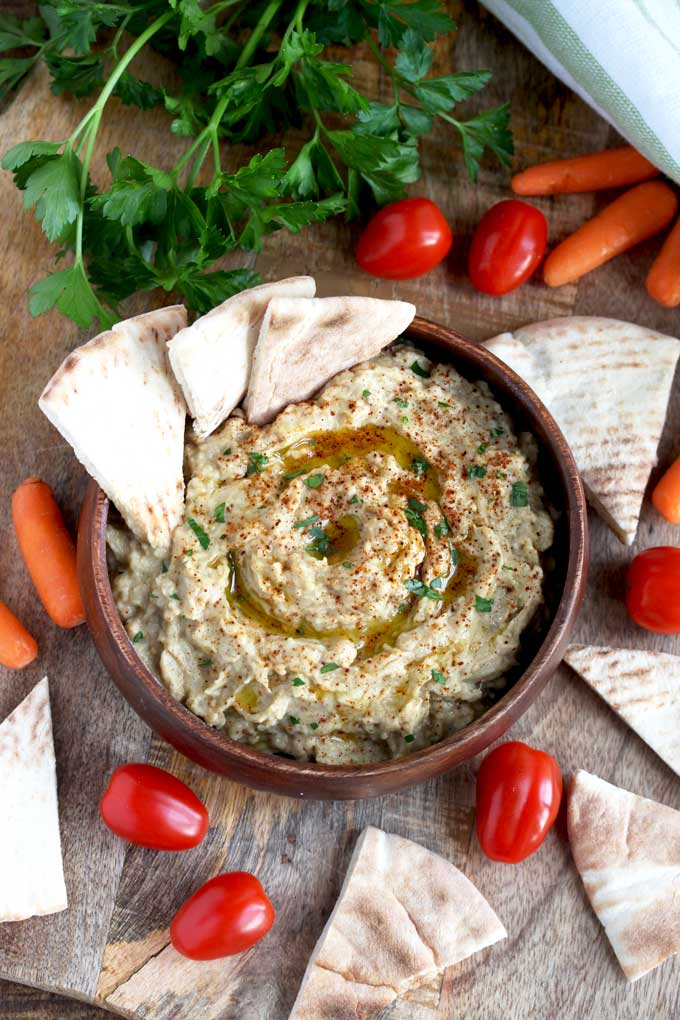 Baba Ganoush recipe served with pita bread, carrots and tomatoes.