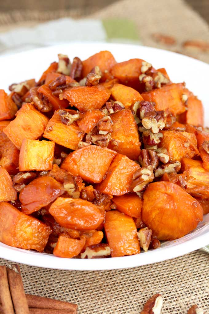 Candied Sweet Potatoes served in a white bowl.