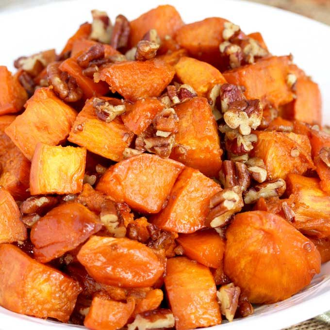 Candied Sweet Potatoes on a white serving bowl