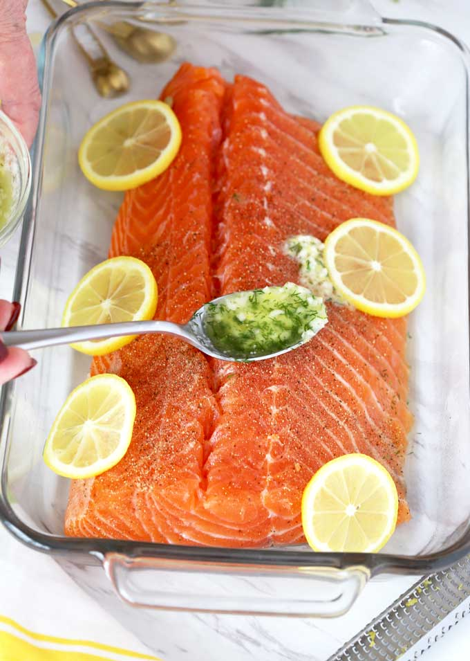 Lemon and Herb butter poured over salmon.