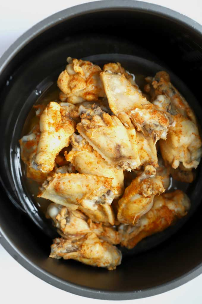 Seasoned chicken wings inside the instant pot.