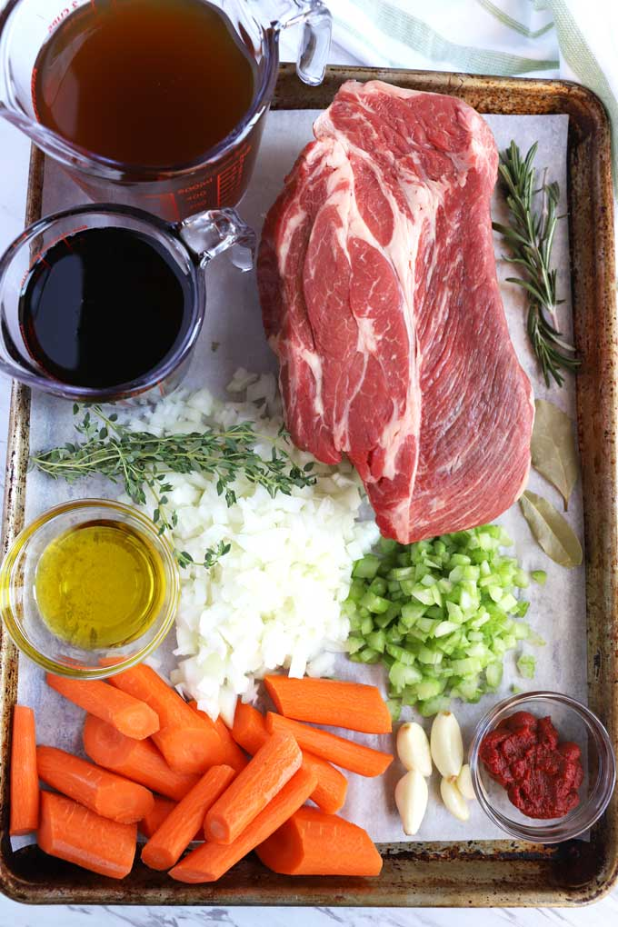 Ingredients to make Instant Pot Pot Roast on a tray.
