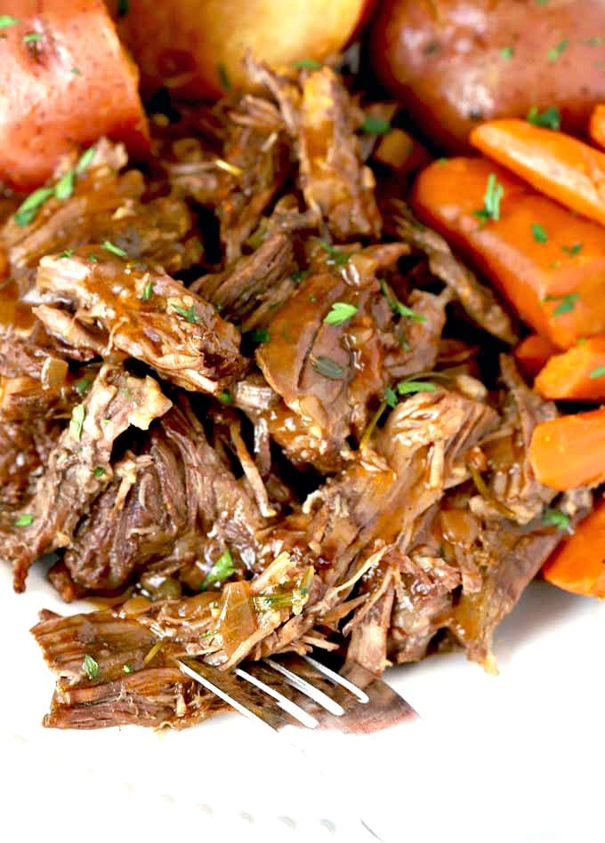 Close up of beef roast with vegetables.