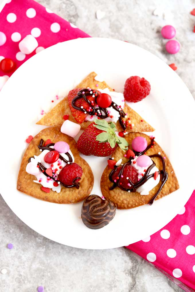 A small plate with heart shaped dessert nachos.