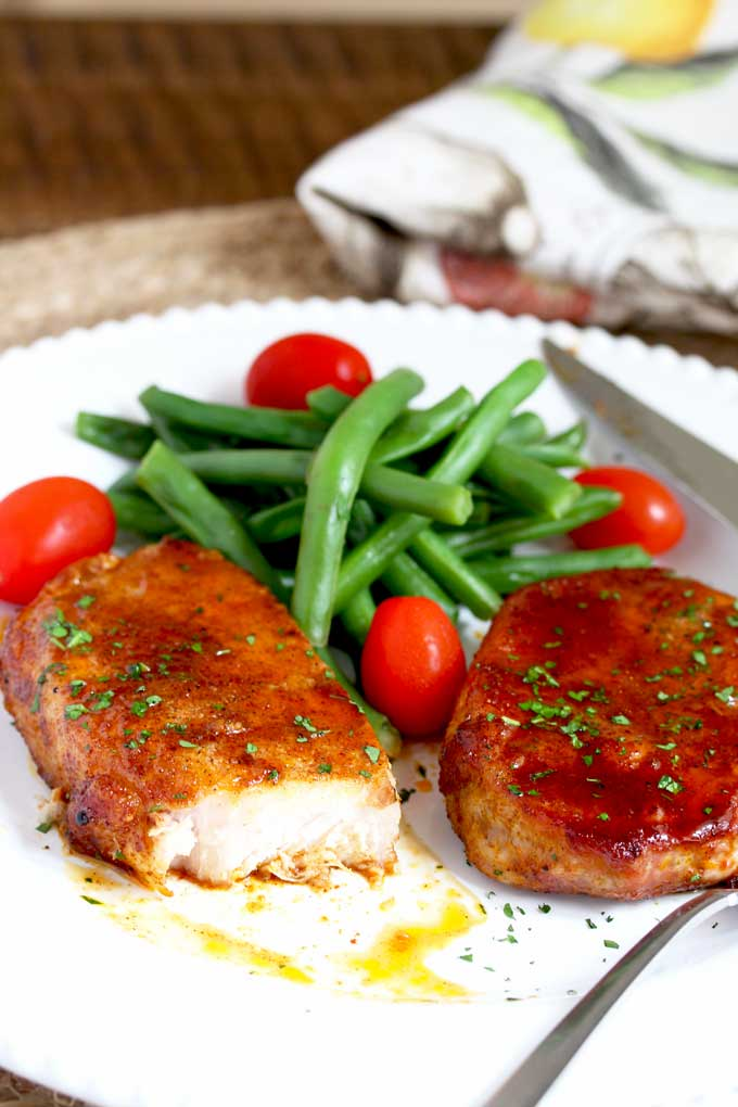 Served Pork Chops with green beans and tomatoes.