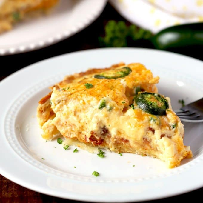 Slice of a jalapeno popper quiche on a white plate