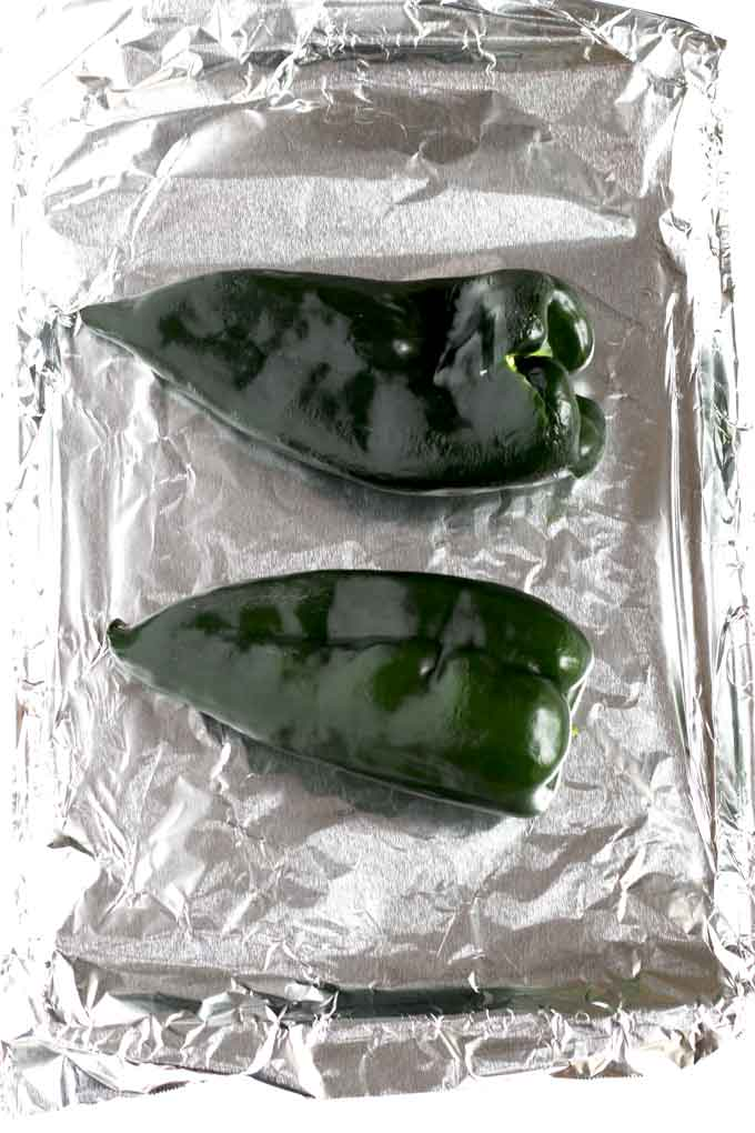 Green Poblano Peppers on a baking sheet.