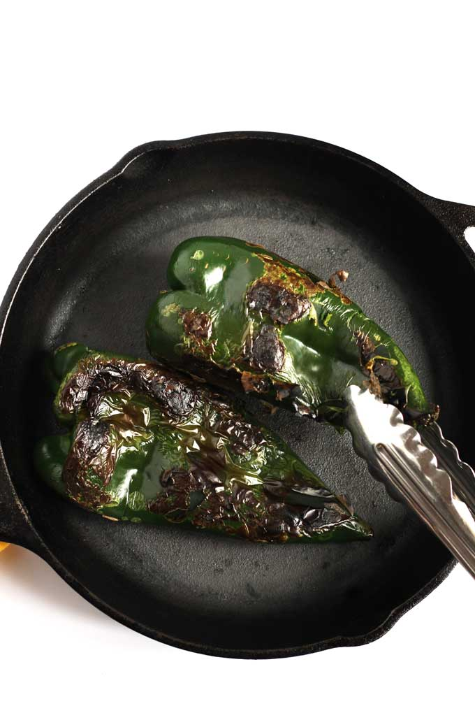 Charred peppers in a skillet