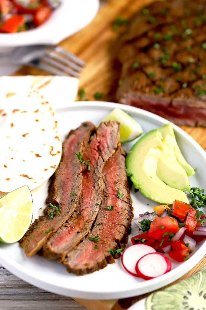 Thin slices of carne asada served with tortillas, pico de gallo and avocado.