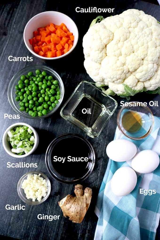 Ingredients to make this fried rice recipe on a black surface.