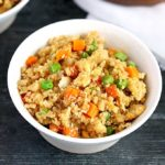 Cauliflower Fried Rice in a white ceramic bowl.