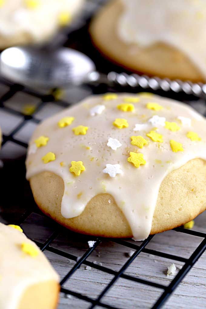 Close up of a Lemon Cookie with Lemon Glaze decorated with white and yellow stars